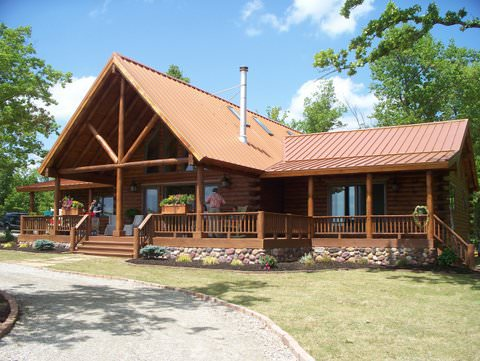 Log Home Designers. At Real Log Homes  are designers our happy to work with clients create the perfect home just for them This project in Mountain Home Arkansas shows how The Wolf Cross Gable Fusion